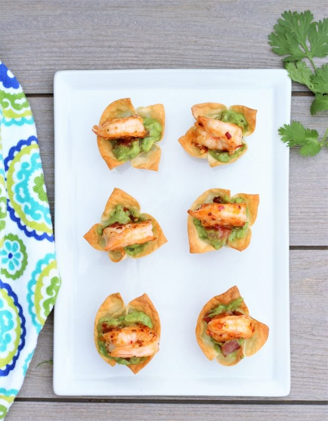 Mini wonton cups filled with guacamole and topped with Thai Sweet Chili Shrimp.