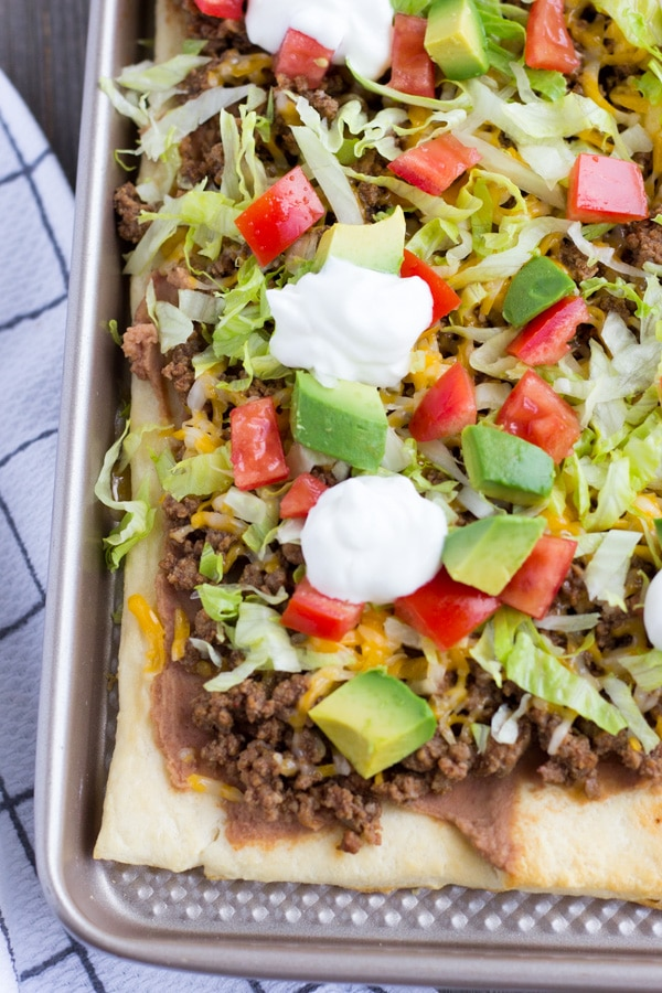 Crescent Dough Taco Pizza on a baking sheet.