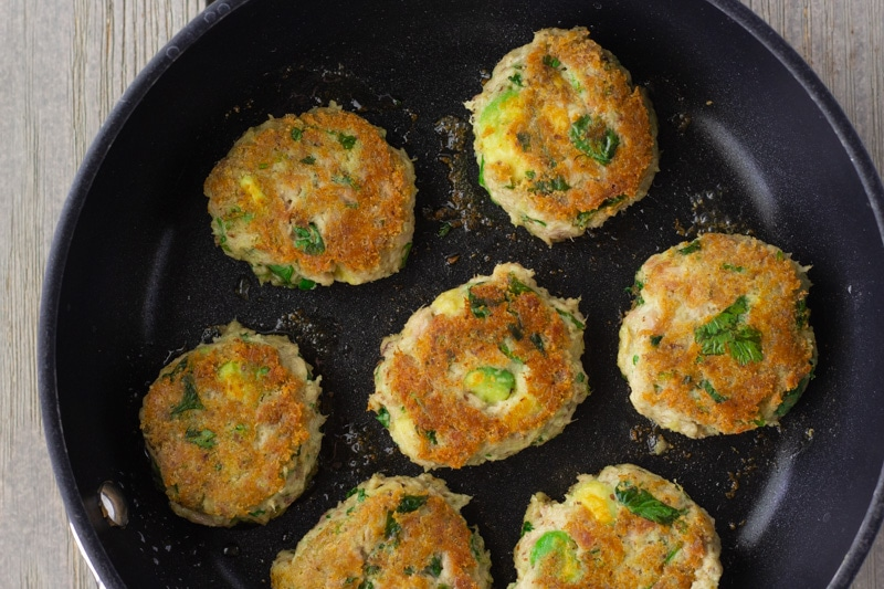 Avocado Cilantro Tuna cakes cooking in a skillet