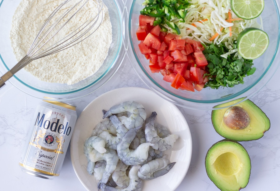 Ingredient spread for beer battered shrimp tacos with spicy slaw.